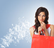 Beautiful woman opening a red shopping bag Royalty Free Stock Photo