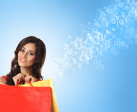 Beautiful woman opening a red shopping bag Royalty Free Stock Photography