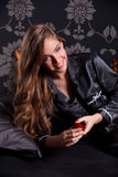 Beautiful woman opening a ring box Royalty Free Stock Photo