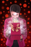 Beautiful Woman opens a Gift Royalty Free Stock Photography