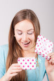 Beautiful woman opens the gift Royalty Free Stock Images