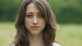 Beautiful woman opens her eyes portrait, female after meditation looks in camera stock video