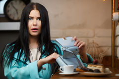 Beautiful woman opens her handbag royalty free stock photo