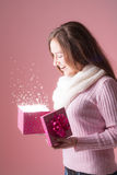 Beautiful woman opens present Royalty Free Stock Photography