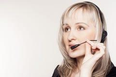 Beautiful woman operator with head-set Stock Photo
