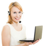 Beautiful woman operator with a laptop Stock Photo