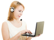 Beautiful woman operator with a laptop Stock Images