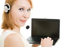 Beautiful woman operator with a laptop stock photo