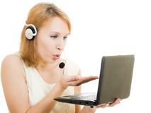 Beautiful woman operator sends a kiss in a laptop Royalty Free Stock Photo
