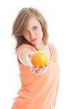 Beautiful woman with an orange. Fruits: beautiful woman holding an orange Royalty Free Stock Photo