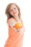 Beautiful woman with an orange. Fruits: beautiful woman holding an orange Stock Photo