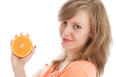 Beautiful woman with an orange. Fruits: beautiful woman holding an orange Royalty Free Stock Photography