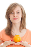 Beautiful woman with an orange. Fruits: beautiful woman holding an orange Royalty Free Stock Photos