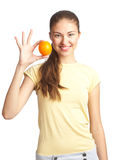Beautiful woman with orange Stock Images