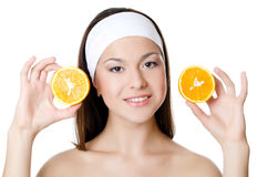 The beautiful woman with a orange Stock Photos
