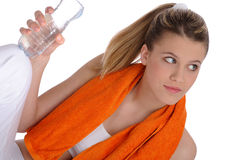 Beautiful woman with orange fitness towel Royalty Free Stock Photos