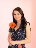 Beautiful woman with orange flower Royalty Free Stock Photography