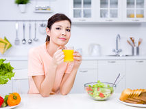 Beautiful woman with orange juice Royalty Free Stock Photography