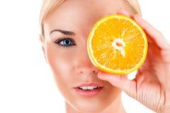 Beautiful woman with orange Stock Photo