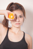 Beautiful woman with orange slice royalty free stock photography