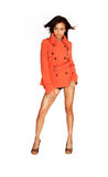 Beautiful woman in orange trench coat Stock Photo