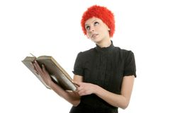 Beautiful woman, orange wig reading old book Royalty Free Stock Images