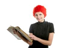 Beautiful woman, orange wig reading old book Royalty Free Stock Photography