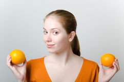 Beautiful woman with oranges Stock Photo