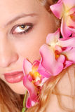 Beautiful woman with orchid Stock Photos