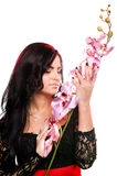 Beautiful woman with orchid Royalty Free Stock Photo