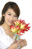 Beautiful woman and orchid Stock Photos