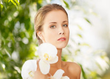 Beautiful woman with orchid flower Stock Photography