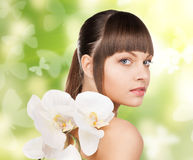 Beautiful woman with orchid flower and butterflies Stock Photo
