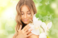 Beautiful woman with orchid flower and butterflies Royalty Free Stock Image