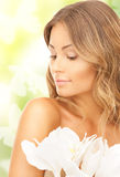 Beautiful woman with orchid flower and butterflies Stock Photography