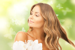 Beautiful woman with orchid flower and butterflies Stock Image