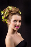 Beautiful woman with orchid flower in hair posing Royalty Free Stock Photo