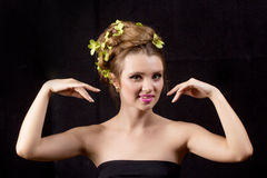 Beautiful woman with orchid flower in hair posing Stock Photos