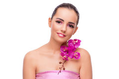 The beautiful woman with orchid flower isolated on white Stock Image