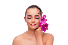 The beautiful woman with orchid flower isolated on white Stock Photo