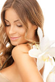 Beautiful woman with orchid flower Stock Photo