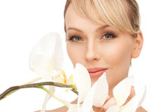 Beautiful woman with orchid flower Stock Image