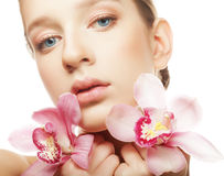 beautiful woman with a orchid  flowers. Stock Photos