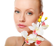 Beautiful woman with orchid over white background Stock Photo