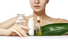 Beautiful woman with Organic Cosmetic, Oils for Beauty Treatment. Spa and Wellness. Model with clean skin. Healthcare. Beautiful woman applies Organic Cosmetic stock image