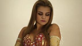 Beautiful woman in oriental bra is dancing belly dance. Arabic oriental dance. stock footage