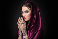 Beautiful woman in oriental style with mehendi Royalty Free Stock Photography