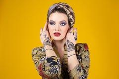 Beautiful woman in oriental style with mehendi in hijab Stock Image