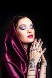 Beautiful woman in oriental style with mehendi in hijab Stock Photos