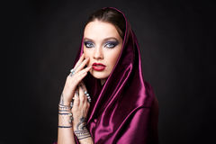 Beautiful woman in oriental style with mehendi in hijab Stock Photos